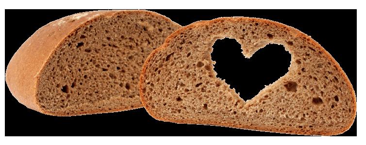 Das Bild zeigt ein aufgeschnittenes Brot mit einem ausgestanzten Herz in der Mitte